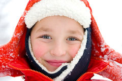 Winter day (2). Cheerful boy outside in a snowy day Royalty Free Stock Photography