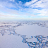 Winter day above frozen tundra lakes, top view Royalty Free Stock Photos