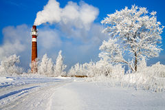 Winter day and industrial air pollution Stock Image