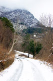 Winter day in the mountains. Mountain road one cold winter day Royalty Free Stock Images