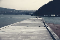 A winter day pier. And sea Stock Images