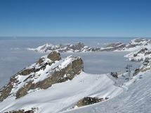 Winter day on the Titlis, Chair lift Stock Photos
