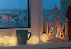 Winter decor with candles and garland. The winter decor with candles and garland Royalty Free Stock Photo