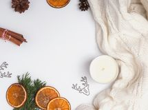 Winter decor and white knitted sweater. Top view stock image