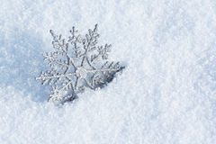 Winter decoration. Beautiful silver snowflake in snow Royalty Free Stock Photos