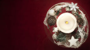 Winter decoration with candles on red background Stock Photos