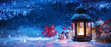 Winter Decoration with a Candlestick Near the Snow-Covered Windo Royalty Free Stock Images