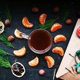 Winter decoration. Composition on wood background. Hot tea, candles, cut grapefruit. Christmas. Christmas mood. Christmas spirit. Royalty Free Stock Photography