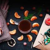 Winter decoration. Composition on wood background. Hot tea, candles, cut grapefruit. Christmas. Christmas mood. Christmas spirit. Stock Image