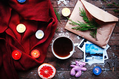 Winter decoration. Composition on wood background. Hot tea, candles, cut grapefruit. Christmas. Christmas mood. Christmas spirit. Stock Photo