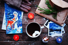 Winter decoration. Composition on wood background. Hot tea, candles, cut grapefruit. Christmas. Christmas mood. Christmas spirit. Royalty Free Stock Images