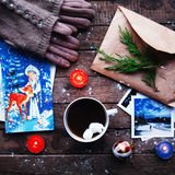 Winter decoration. Composition on wood background. Hot tea, candles, cut grapefruit. Christmas. Christmas mood. Christmas spirit. Stock Photo