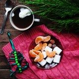 Winter decoration. Composition on wood background. Hot tea, candles, cut grapefruit. Christmas. Christmas mood. Christmas spirit. Stock Images