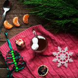 Winter decoration. Composition on wood background. Hot tea, candles, cut grapefruit. Christmas. Christmas mood. Christmas spirit. Royalty Free Stock Photos