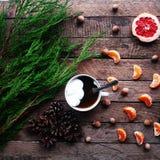 Winter decoration. Composition on wood background. Hot tea, candles, cut grapefruit. Christmas. Christmas mood. Christmas spirit. Stock Photos