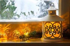 Winter decoration with lantern on windowsill stock image