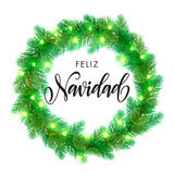 Winter decoration ornament spanish Christmas lights Feliz Navidad. Spanish Merry Christmas text. Feliz Navidad calligraphy greeting. Decorative wreath of Royalty Free Stock Photos
