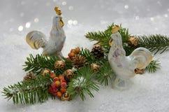 Winter decoration with porcelain cockerels Stock Images