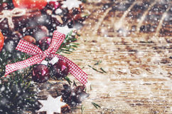 Winter decoration with red balls, gingerbread cookies, xmas tree  twigs Stock Photography