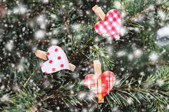 Winter decoration with red heart pins on xmas tree Stock Photography