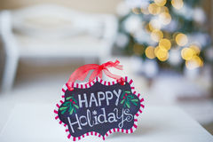 Winter decorations with Happy holidays sign. On bokeh background Stock Image