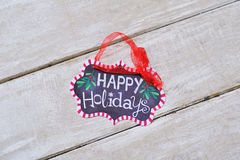 Winter decorations with Happy holidays sign Stock Images