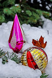 Winter decorations placed on a snowy tree Royalty Free Stock Photo