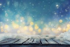 Winter design. Christmas background with Frozen table. Blurred stock photos