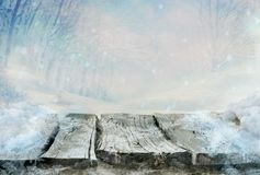 Winter design . Frozen wooden table with landscape stock image