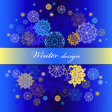 Winter design with gold and blue snowflakes on dark background. Royalty Free Stock Image
