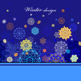 Winter design with golden and blue snowflakes on dark background. Stock Photos