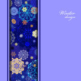 Winter design with golden and blue snowflakes on dark background. Royalty Free Stock Photography