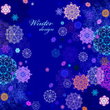 Winter design with pink and blue snowflakes on dark background. Royalty Free Stock Photography