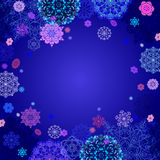 Winter design with pink and blue snowflakes on dark background. Royalty Free Stock Images