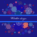 Winter design with red and blue snowflakes on dark background. Stock Image