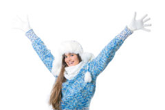 Winter discounts. place for text. Bright emotions of the girl, girl in white winter hat and a blue knit sweater on white background. Girl heard about the crazy Royalty Free Stock Photography