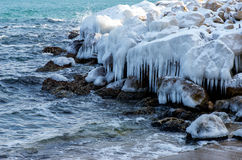 Winter draws on sea rocks patterns and icicles Royalty Free Stock Photo