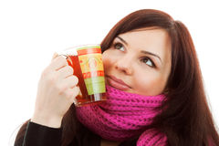 Winter dreams. Girl with cup of tea in pink scarf Stock Photography