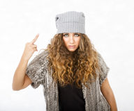 Winter dress for a girl made rude gesture Stock Photos