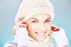 Winter dress up. Pretty woman with scarf and winter cap royalty free stock photos
