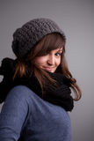 Winter dressed pretty woman smiling Stock Image