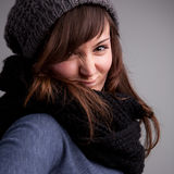 Winter dressed pretty woman smiling Royalty Free Stock Photography