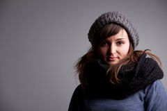 Winter dressed pretty woman smiling Stock Images