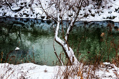 Winter river. River surrounded by freshly fallen snow Stock Image