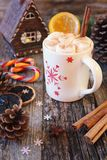 Winter drink: cup of hot chocolate with marshmallow and two french candies. Winter drink: cup of hot chocolate with marshmallow and two french sucking candies Stock Image