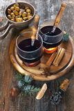 Winter drink: mulled wine with honey and roast chestnuts Royalty Free Stock Photos