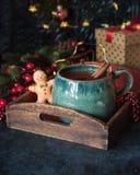 Winter drink Tea with cinnamon. Christmas hot tea with lemon and cinnamon at the table with christmas decoration stock image