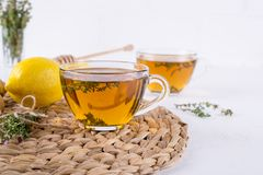 Winter drink. Warming hot tea with lemon, ginger, and herbs thyme,. Copy space stock photos