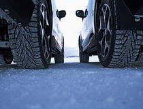 Winter drive safety. Studded tires against studless tires Royalty Free Stock Photo
