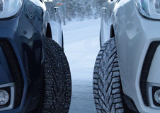 Winter drive safety. Studded tires against studless tires Royalty Free Stock Image
